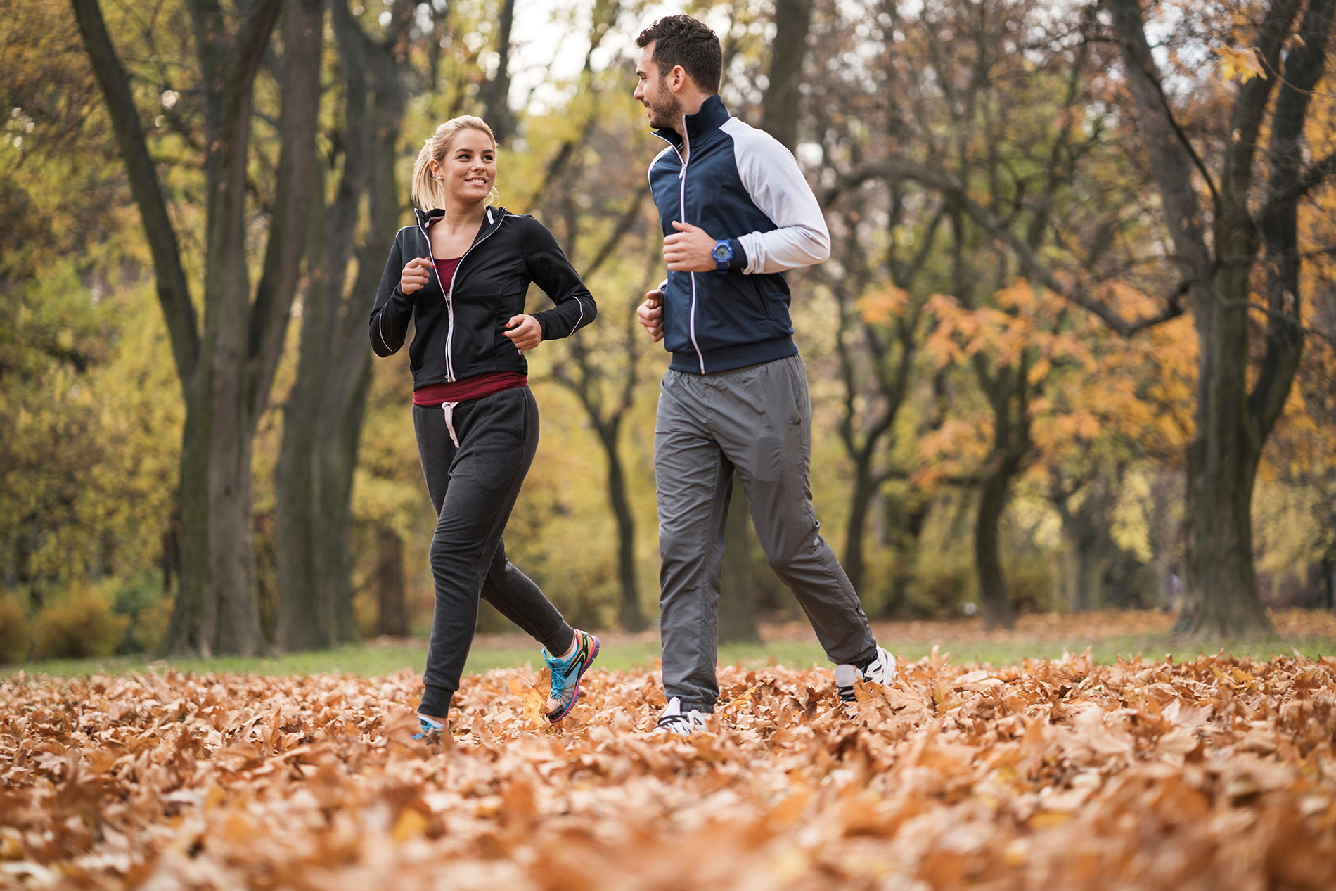 couple-jogging-in-woods